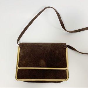 Vintage brown velvet purse with brass trim.